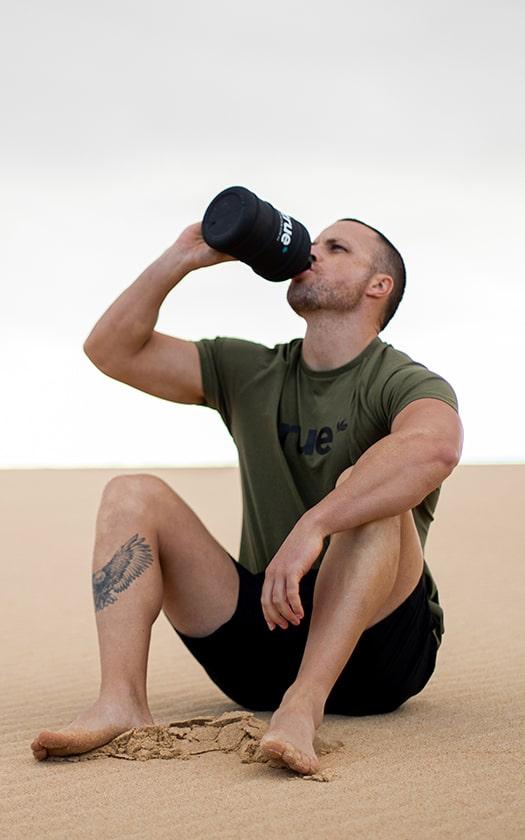 Athlete Drinking from True Bottle